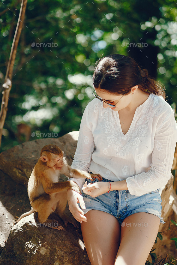 girl playing with monkey - Stock Photo - Images