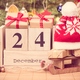 Date 24 December, gifts with sled and cap, tree with decoration - PhotoDune Item for Sale