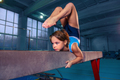 beautiful girl is engaged in sports gymnastics on a log - PhotoDune Item for Sale