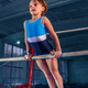 beautiful girl is engaged in sports gymnastics on a parallel bars - PhotoDune Item for Sale