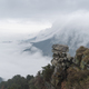 waterfall clouds spilling over the leeward slope of lushan mountain, jiangxi province, China - PhotoDune Item for Sale