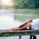 Yoga Woman by The Lake. Balasana - PhotoDune Item for Sale