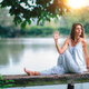 Yoga Woman by The Lake. Seated Spinal Twist - PhotoDune Item for Sale