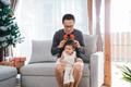 portrait of father helped a little daughter wearing deer headban - PhotoDune Item for Sale