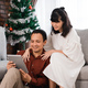 lovely couple using tablet in christmas day - PhotoDune Item for Sale
