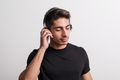 Portrait of a joyful young hispanic man with headphones in a studio. - PhotoDune Item for Sale