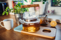 Composition of tea in a teapot, sugar, lemon and cup on wooden table. - PhotoDune Item for Sale