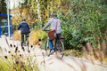 A rear view of active senior couple with electrobikes cycling outdoors on pathway in town. - PhotoDune Item for Sale