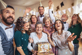 A portrait of multigeneration family with presents on a indoor birthday party. - PhotoDune Item for Sale