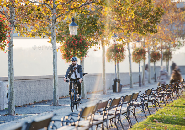 Hipster businessman commuter with bicycle traveling home from work in city. - Stock Photo - Images