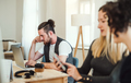 Group of young businesspeople with smartphone working together in a modern office. - PhotoDune Item for Sale