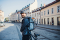 Male courier with backpack delivering packages in city. - PhotoDune Item for Sale
