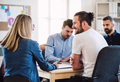 Group of young businesspeople sitting around table in a modern office, having meeting. - PhotoDune Item for Sale