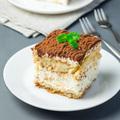 Piece of traditional italian Tiramisu dessert cake on white plat - PhotoDune Item for Sale