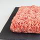 Minced meat from pork and beef, ground meat on dark slate board, - PhotoDune Item for Sale