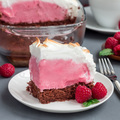 Piece of baked Alaska with chocolate sponge cake, raspberry ice - PhotoDune Item for Sale