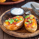 Baked loaded potato skins with cheddar cheese and bacon, garnish - PhotoDune Item for Sale