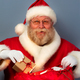 Free Download Santa Claus putting gifts into his sack Nulled
