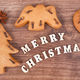 Fresh baked gingerbreads and inscription Merry Christmas as festive decoration - PhotoDune Item for Sale