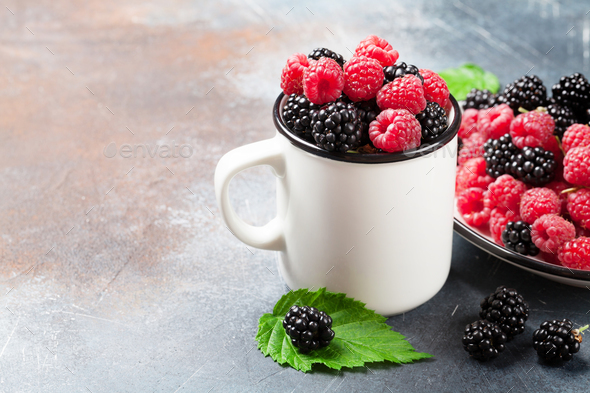 Cup of ripe blackberries and raspberries - Stock Photo - Images