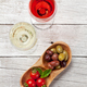 White and rose wine glasses with olives and tomatoes - PhotoDune Item for Sale