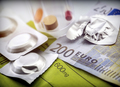 Pastilla effervescent next to medication daily on a ticket of 200 euros, concept of copayment health - PhotoDune Item for Sale