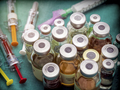 Different types of vials with medication along some syringes in a hospital, conceptual image - PhotoDune Item for Sale