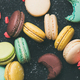 Flat-lay of sweet colorful French macaroon cookies variety, wide composition - PhotoDune Item for Sale
