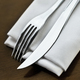 Free Download Fork and knife and napkin on a table set Nulled