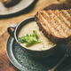 Free Download Celery cream soup and toast over linen tablecloth, square crop Nulled