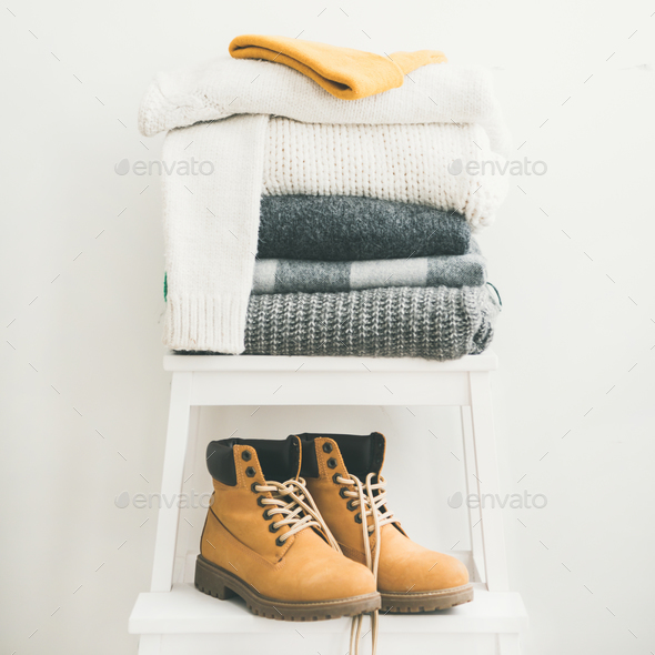 Pile of warm sweaters, blankets, cap and boots, square crop - Stock Photo - Images