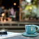 Free Download Coffee on wooden table and smartphone on magazine. Nulled