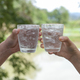 Hands holding a glass of water for clink glasses. - PhotoDune Item for Sale