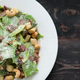 Free Download Caesar salad on wooden floor. Nulled