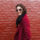 stylish smiling woman in sunglasses and red coat - PhotoDune Item for Sale