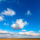 White clouds are crossing blue sky over plain landscape - PhotoDune Item for Sale