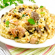 Free Download Risotto with mushrooms and chicken on table Nulled