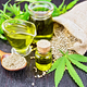 Oil hemp in two jars and sauceboat on board - PhotoDune Item for Sale