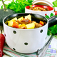 Roast meat and vegetables in white pots on light board - PhotoDune Item for Sale