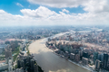 aerial view of shanghai cityscape, winding huangpu river through the city - PhotoDune Item for Sale