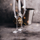 Champagne bottle in bucket with ice, glasses and Christmas decorations - PhotoDune Item for Sale
