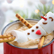 Red mug with cappuccino with melted marshmallow snowman - PhotoDune Item for Sale