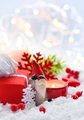 Christmas composition with a candle, gifts and festive decoratio - PhotoDune Item for Sale