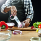 Preparing salad. Female chef cutting fresh vegetables. Cooking process. Selective focus - PhotoDune Item for Sale