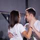 Young couple dancing social danse kizomba in class background - PhotoDune Item for Sale