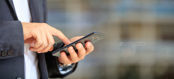 Man holding phone. Young businessman in business wear using a mobile, closeup view on smartphone - Stock Photo - Images