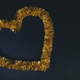Golden heart shape over black background. Love and carnival conc - PhotoDune Item for Sale