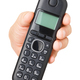Hand with black cordless phone isolated - PhotoDune Item for Sale