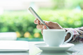 Male hand holding smart phone and cup of coffee_-7 - PhotoDune Item for Sale