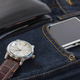 Wrist watch and smartphone on denim jeans - PhotoDune Item for Sale